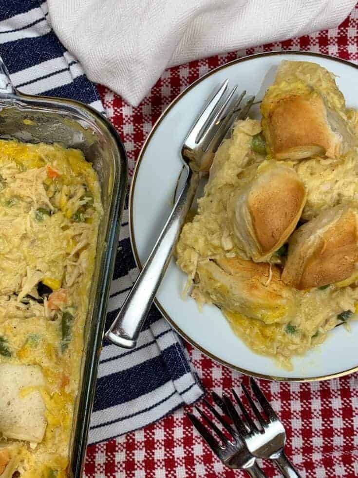Chicken and biscuits in a casserole dish and on a plate.