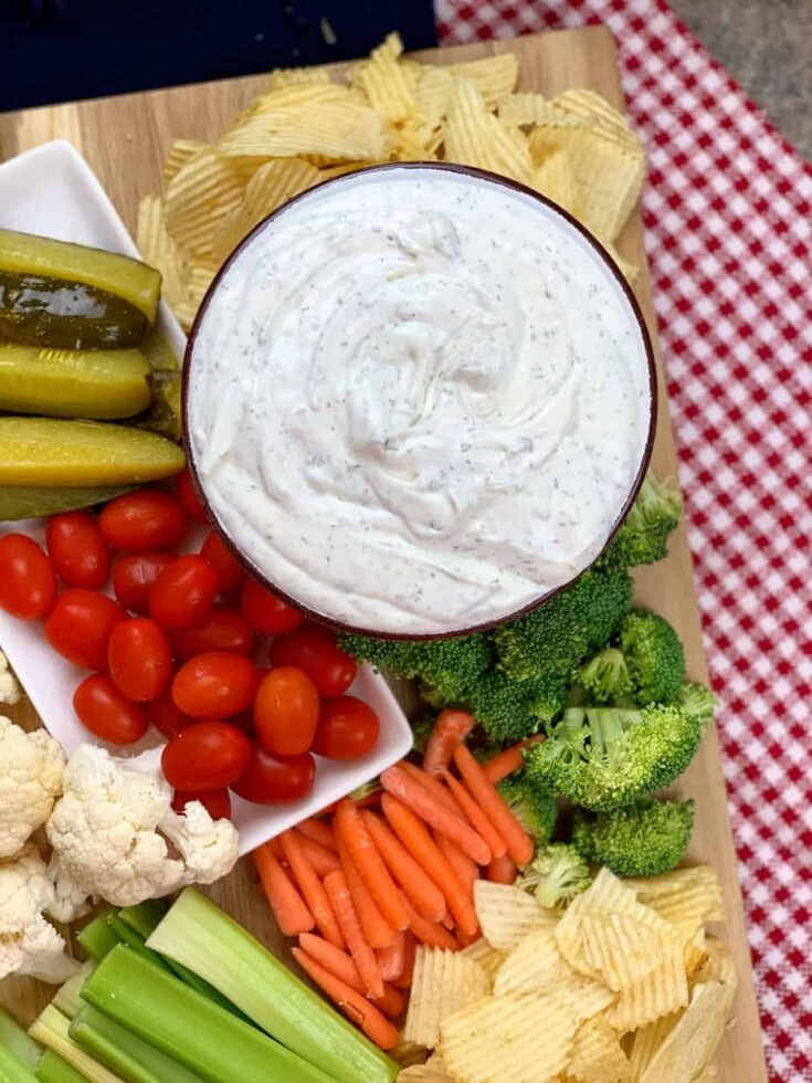 Sour cream dip with veggies and chips