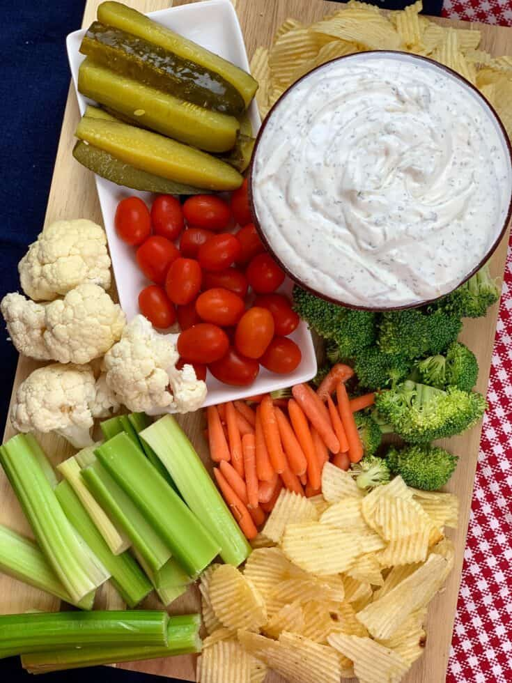 This is one addictive sour cream dip and it's super easy to make. The sour cream dip recipe takes about five minutes to make, is super budget-friendly, and perfect for any occasion including parties, family gatherings, church potlucks, or even as a snack at home. #recipes #easy #forchips #veggie #forcrackers #forpretzels #dill #onion #garlic #homemade