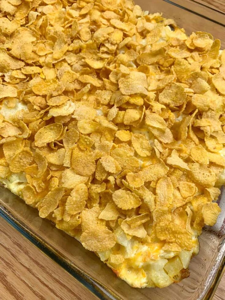 Corn Flakes on top of potatoes in a casserole dish