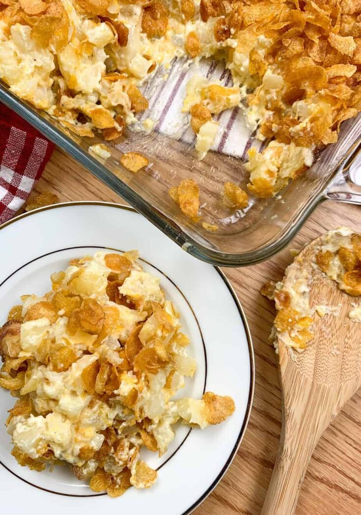 Funeral potatoes on a plate and in a casserole dish
