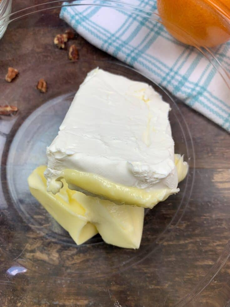 Softened butter and cream cheese in a glass bowl