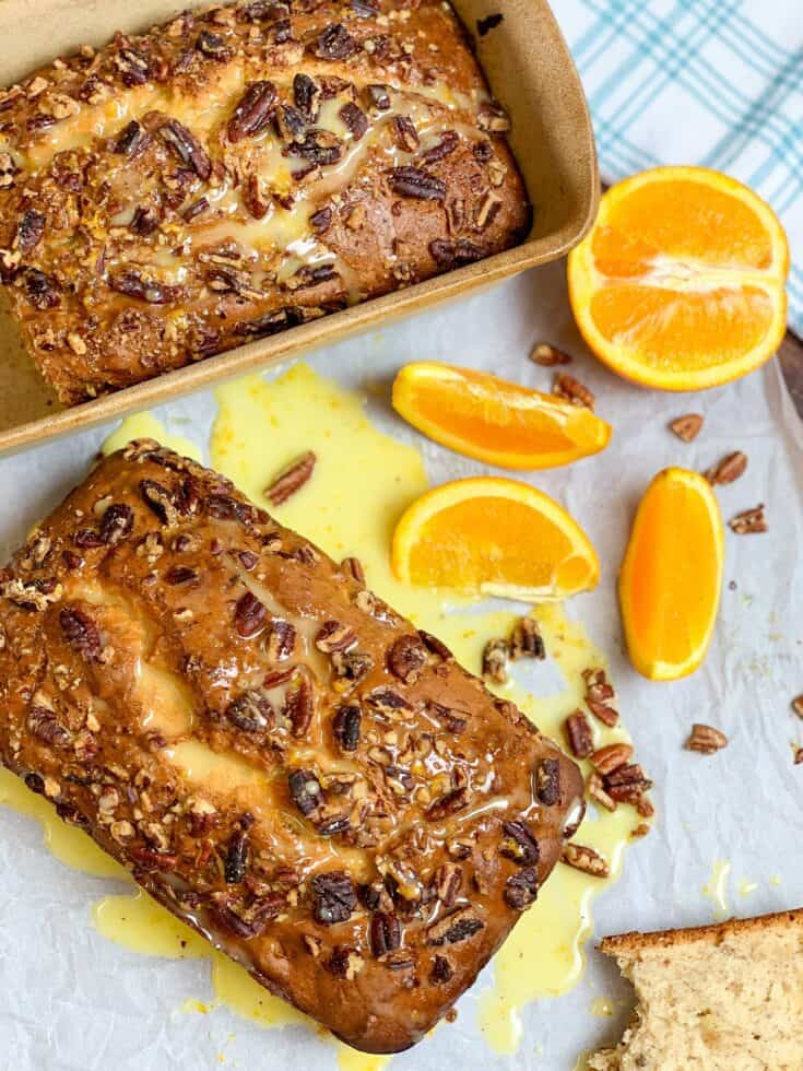This moist and easy recipe for banana nut bread with pecans and orange sugar glaze is absolutely the best. The simple recipe features bananas, cream cheese, chopped pecans, and a flavorful orange sugar glaze.