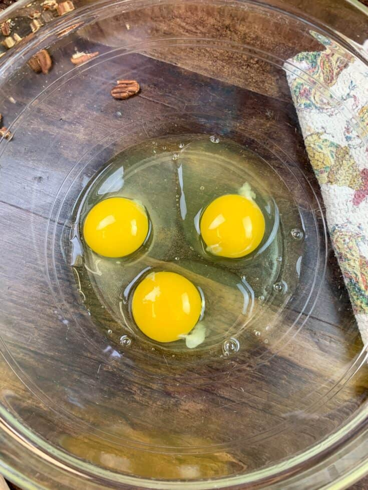 Three eggs in a glass bowl
