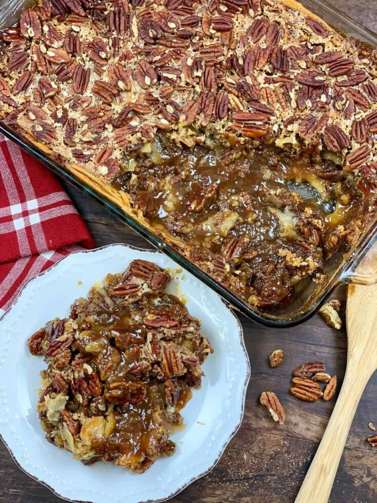 Pecan pie cobbler in a white plate and in a casserole dish