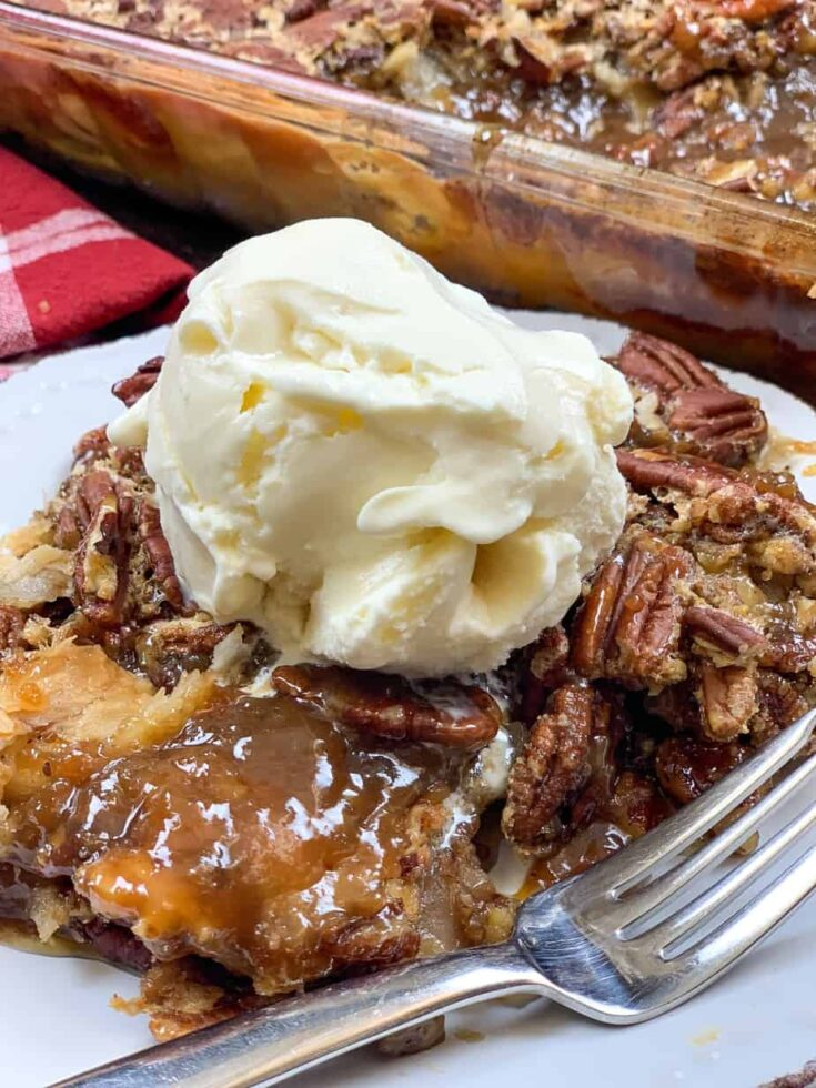 Pecan pie cobbler with ice cream on a plate