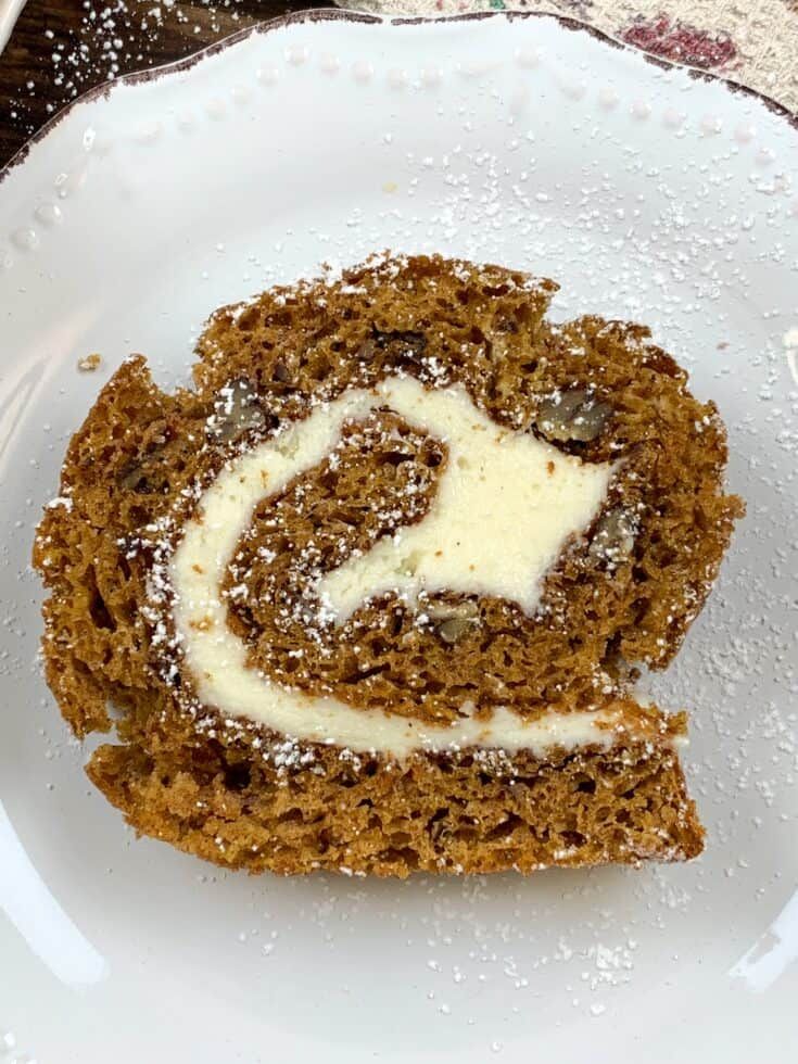 A slice of pumpkin roll cake on a plate