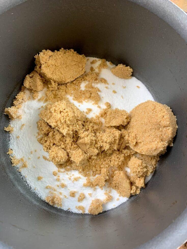 Granulated and brown sugar in a saucepan