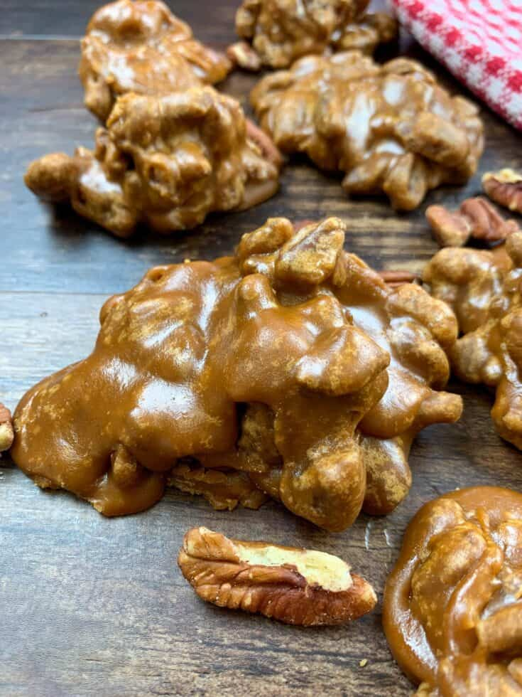 Praline pecans sitting on a counter