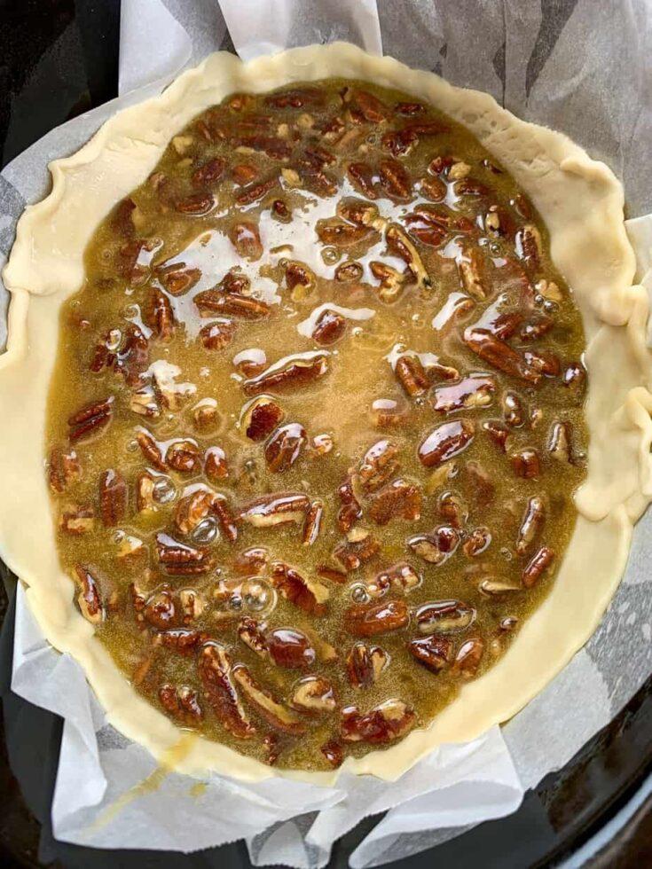 Pecan pie filling in a pie shell in a Crock Pot