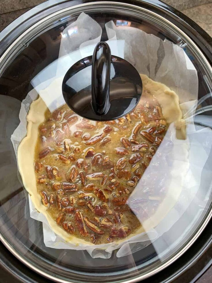 Pecan pie in a Crock Pot with the lid on.