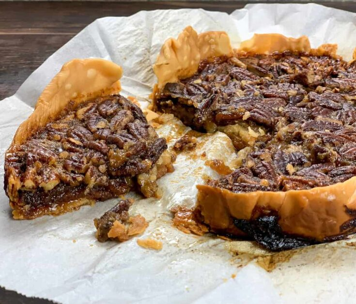 Sliced pecan pie on parchment paper