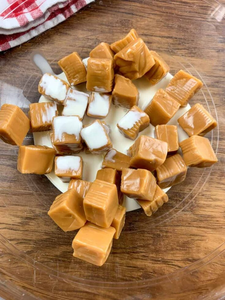 Caramels and heavy cream in a glass bowl