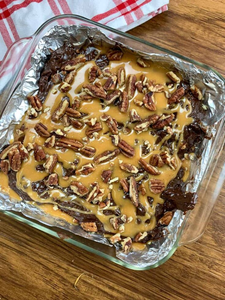 Chocolate fudge with caramel and pecans in a dish