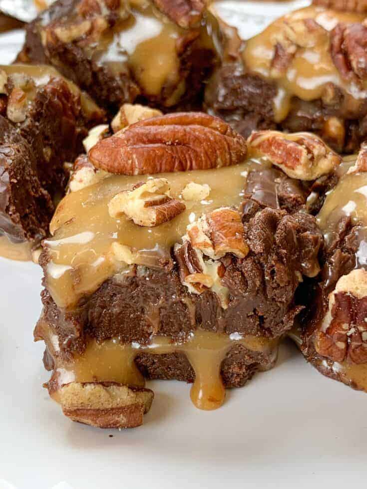 Chocolate turtle fudge is one of the most decadent and delicious treats and is an easy homemade recipe to make. The warm caramel oozes through the center of the fudge and the pecans add a salty and delicious taste to the dessert. Everyone will be begging for this at Thanksgiving and Christmas.