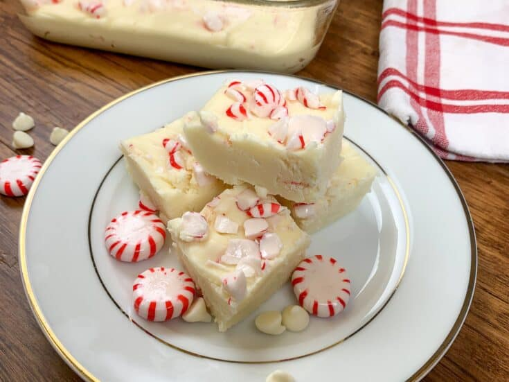 Peppermint fudge on a plate with peppermint candies