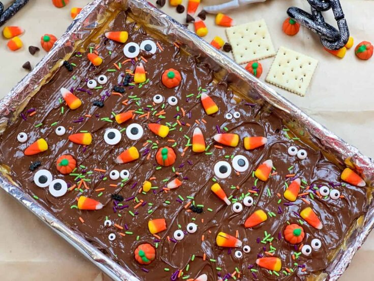 Chocolate crack on a cookie sheet with Halloween candy decorations