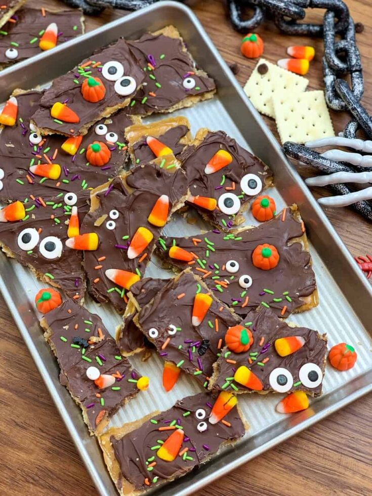 Halloween chocolate crack on a cookie sheet with candy