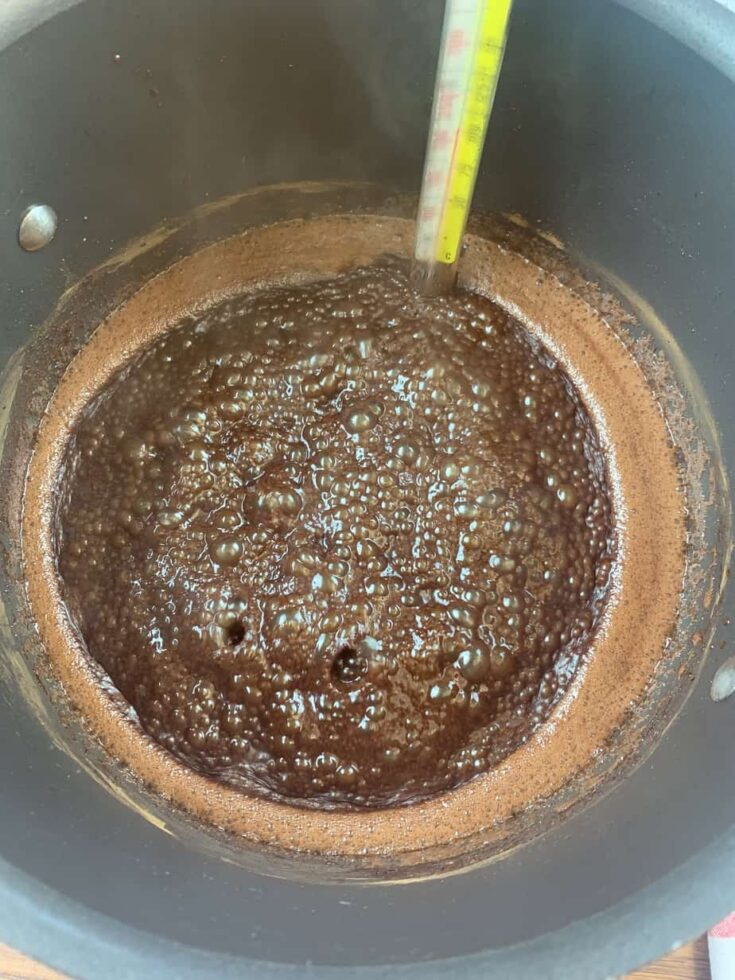 Boiling chocolate fudge in a saucepan