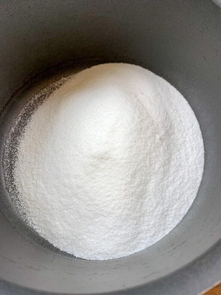 Sugar in a saucepan to make divinity fudge