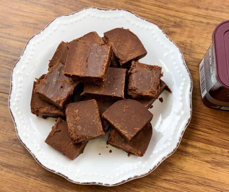 Chocolate fudge cut up into pieces and sitting on a plate