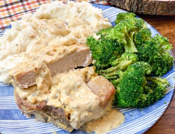 Sliced pork chops on a plate with broccoli