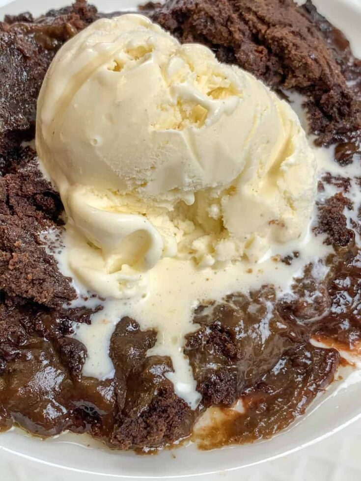 slow cooker cake with a scoop of ice cream on top
