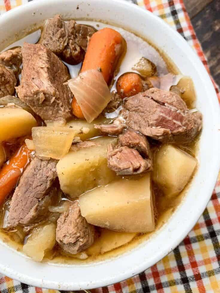 Slow cooker beef stew in a white bowl