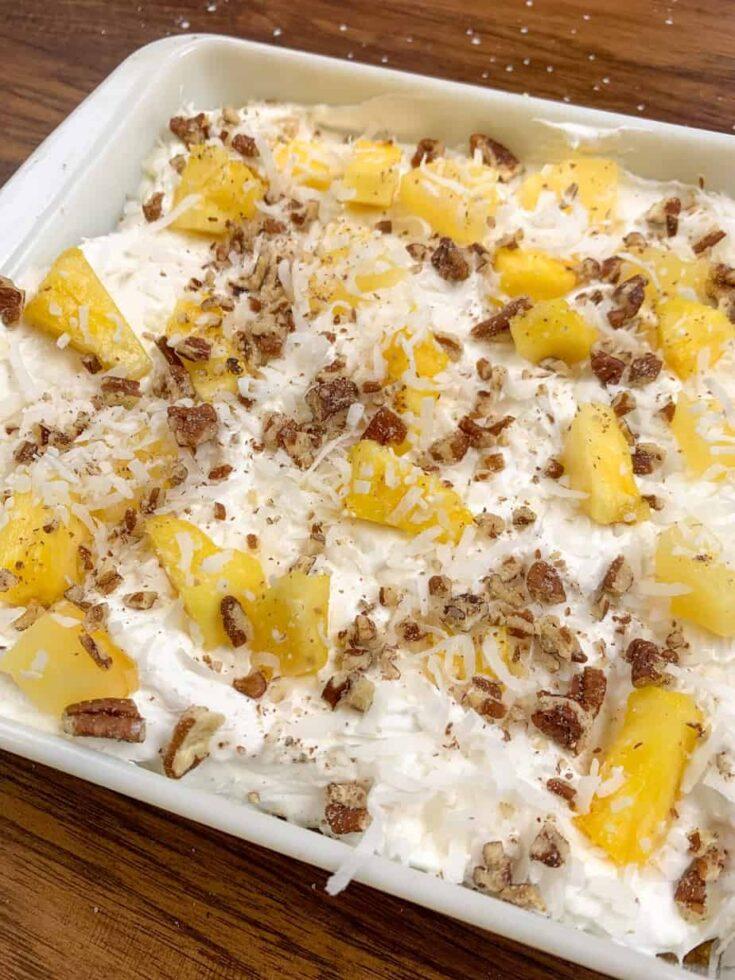 Pineapple lush dessert in a casserole dish