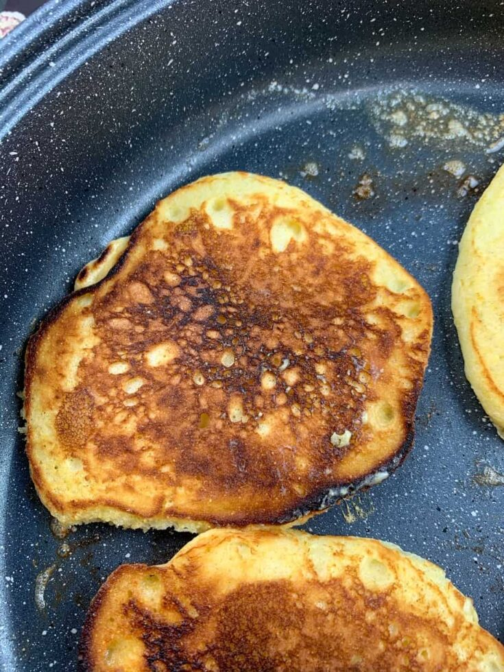 Cooking Jiffy Cornbread pancakes in a skillet