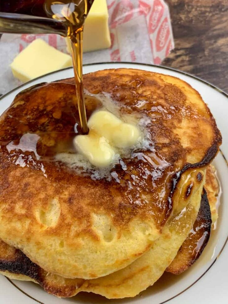 Pouring syrup on the fluffiest buttermilk pancakes