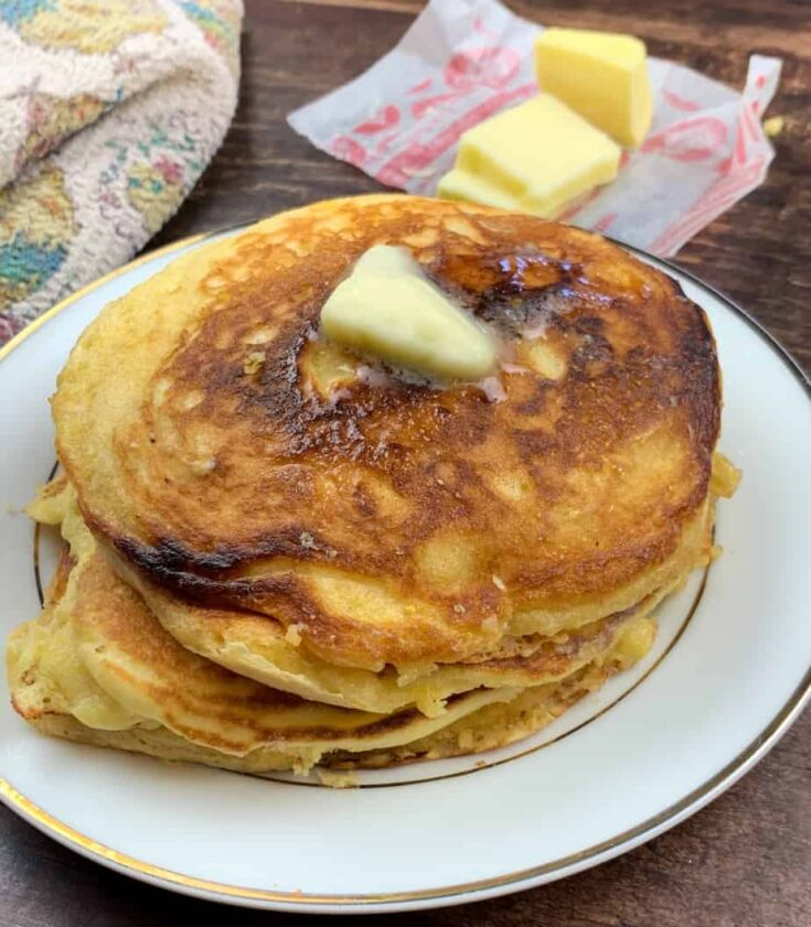 Jiffy Cornbread pancakes with butter melting on top