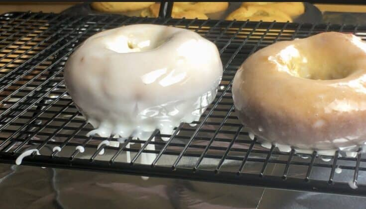 Glazed donuts on a cookie cooling rack