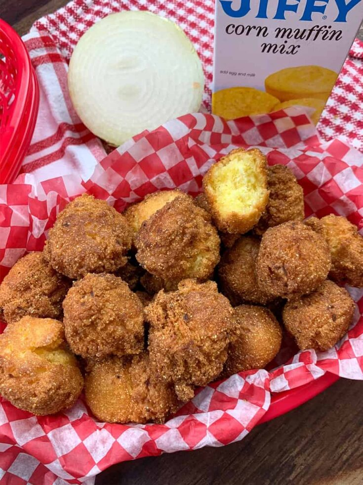 A pile of hush puppies in a basket