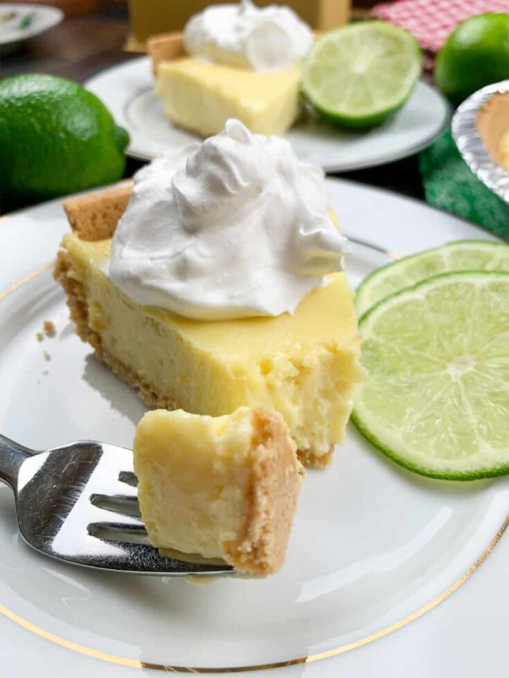 A piece of key lime pie on a plate with a fork