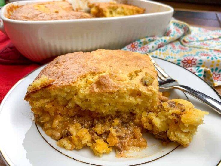 Jiffy cornbread tamale pie on a white plate with a fork