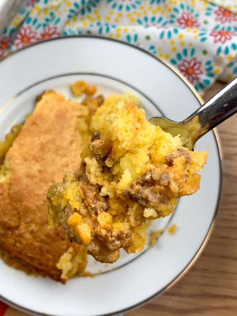 A fork filled with Jiffy cornbread tamale pie