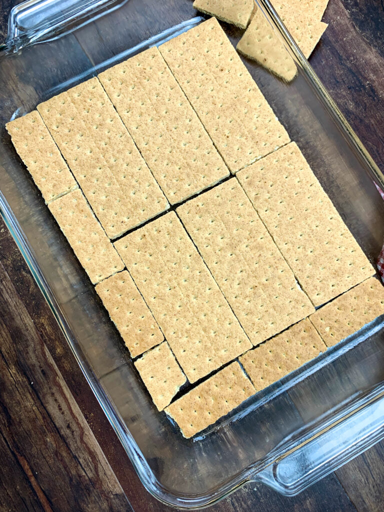 Graham crackers in the bottom of a 9 x 13 casserole dish