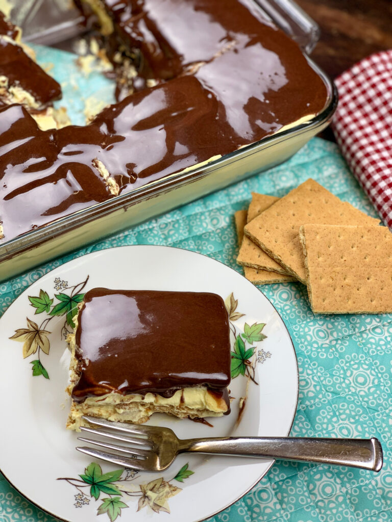 Eclair cake on top of a plate with a fork.