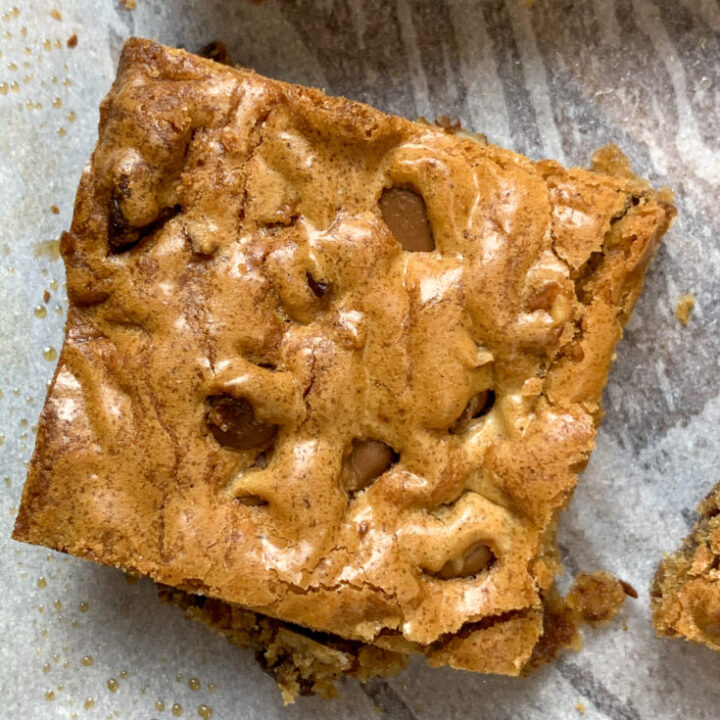 Sliced brown butter blondie on parchment paper