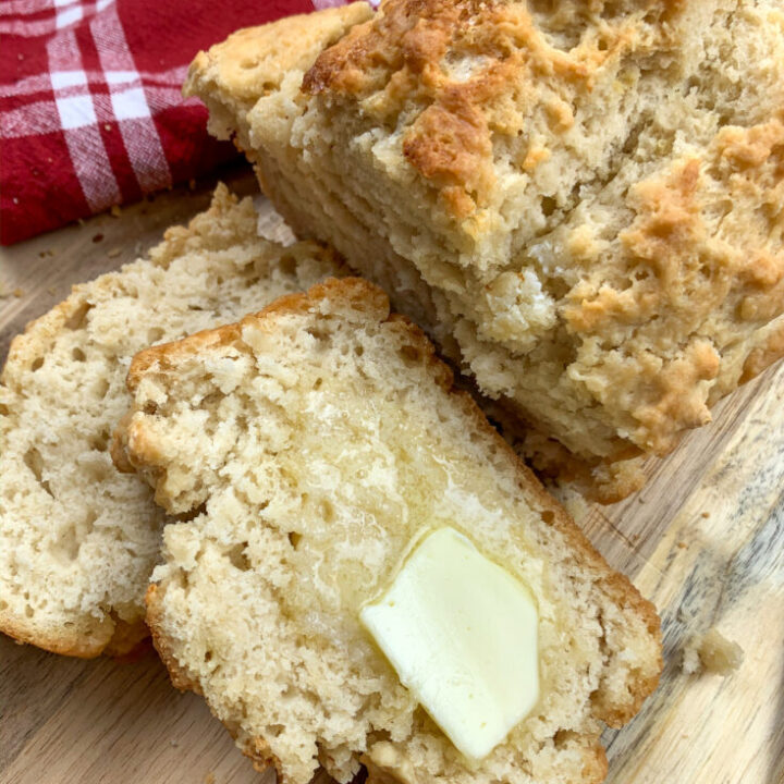 Sliced homemade beer bread with melting butter