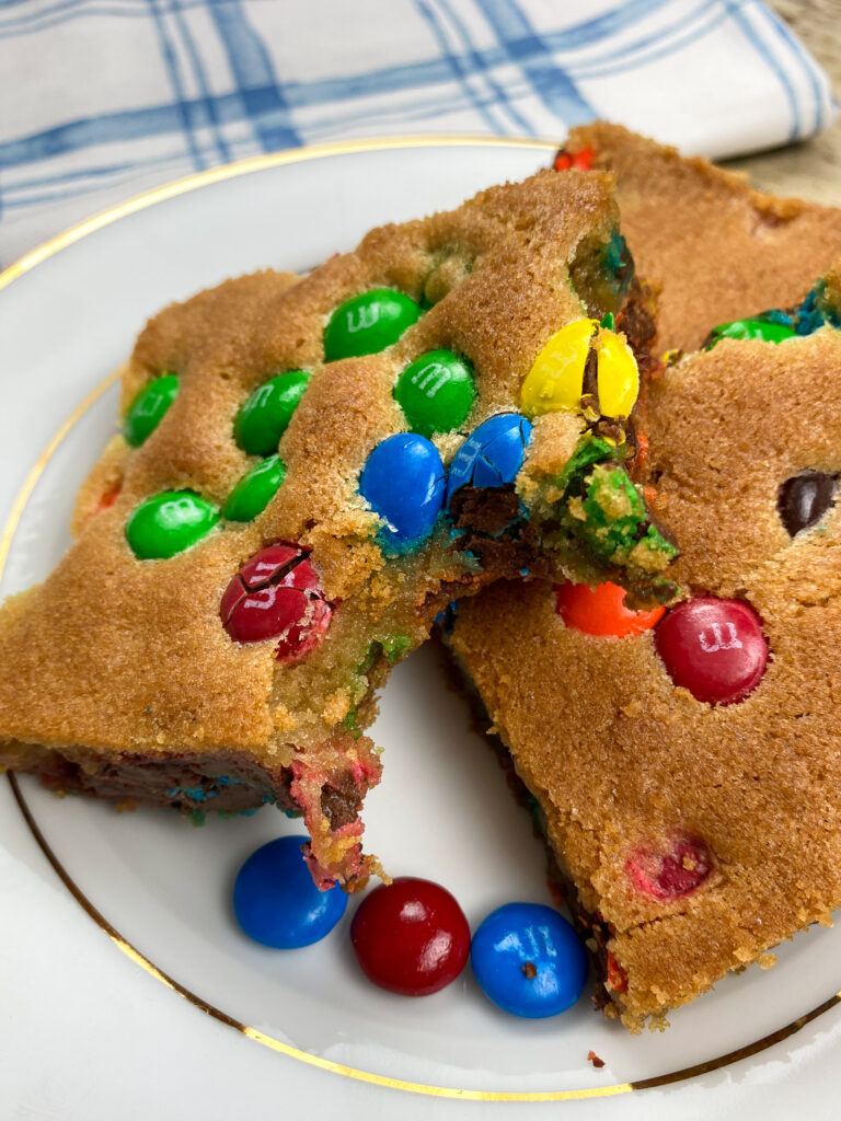 M and M Cookie bars on a plate.