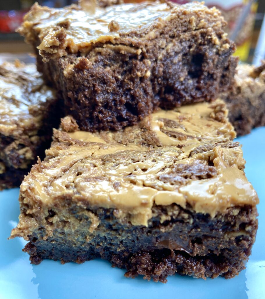 Peanut butter brownies stacked on top of each other.