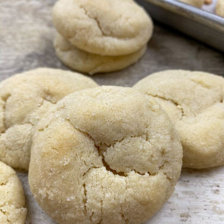 Soft and chewy sugar cookies on a counter.