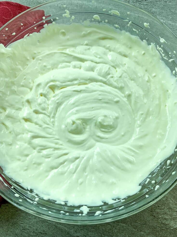 Picture of pudding and cream cheese mixed together in a glass bowl.