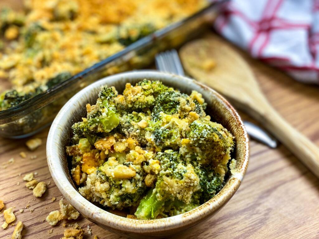 Broccoli cheddar casserole in a small bowl.