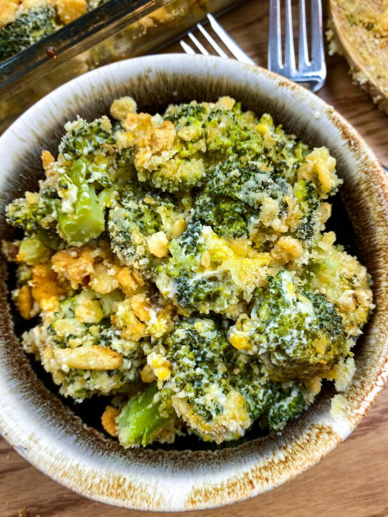 Broccoli cheddar casserole in a bowl.
