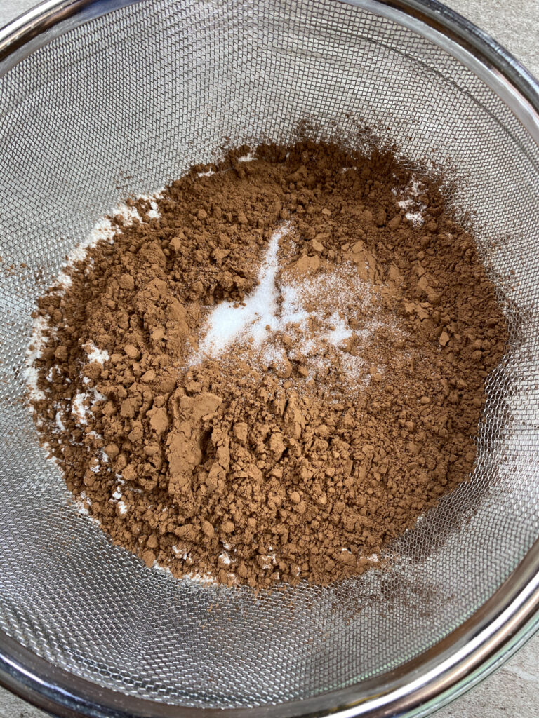 Cocoa and flour in a sifter.