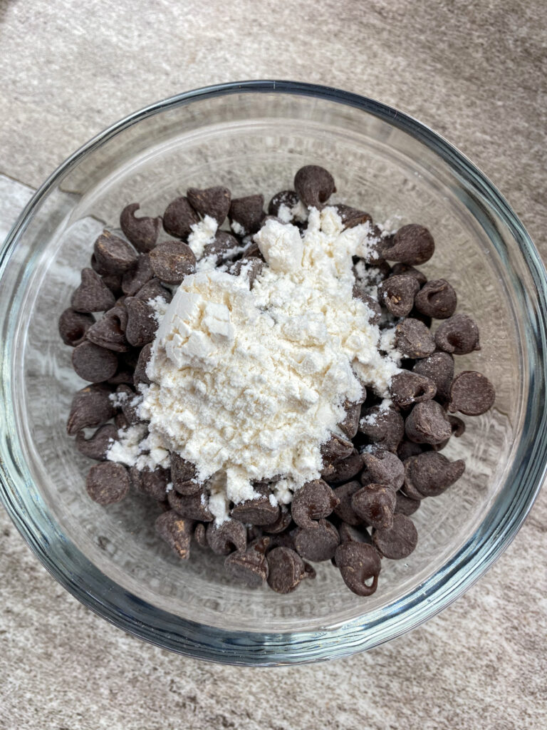 Chocolate chips and flour in a small bowl.
