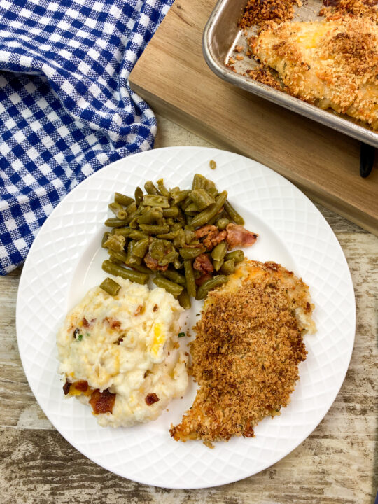 Panko Chicken on a plate with green beans and mashed potatoes